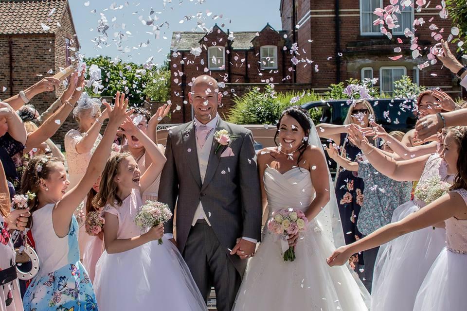 Newlyweds confetti walk