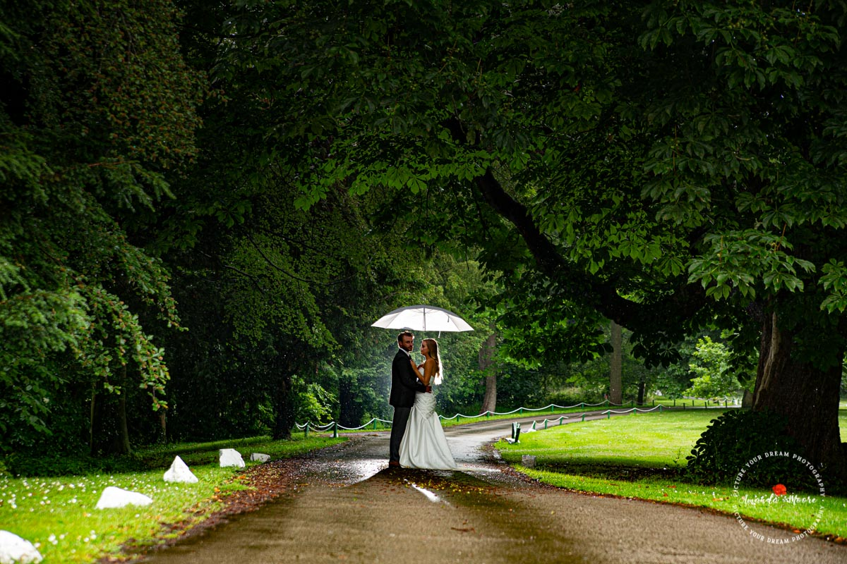 Bride and groom in forest wedding photo
