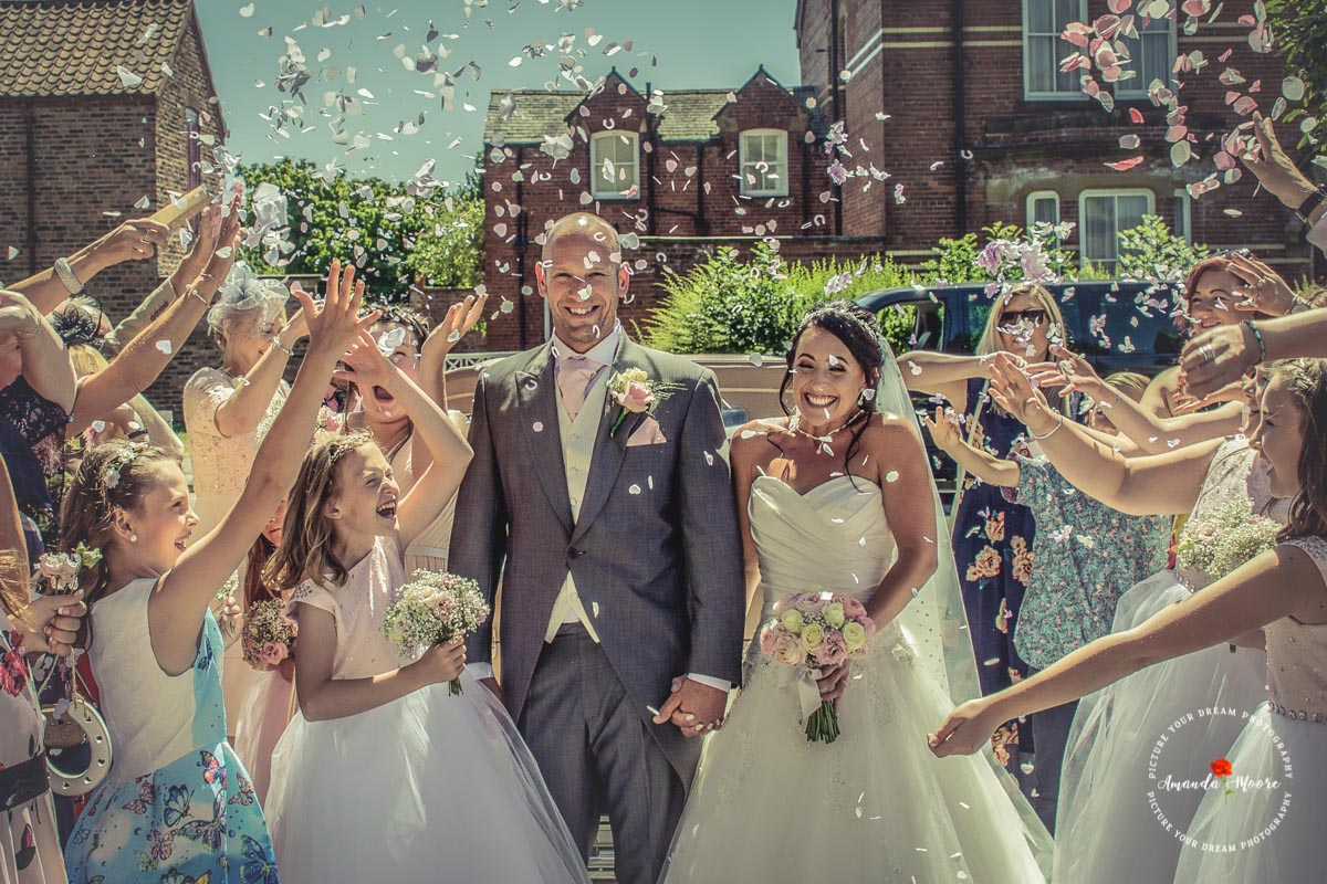 Bride Groom confetti walk wedding photograph