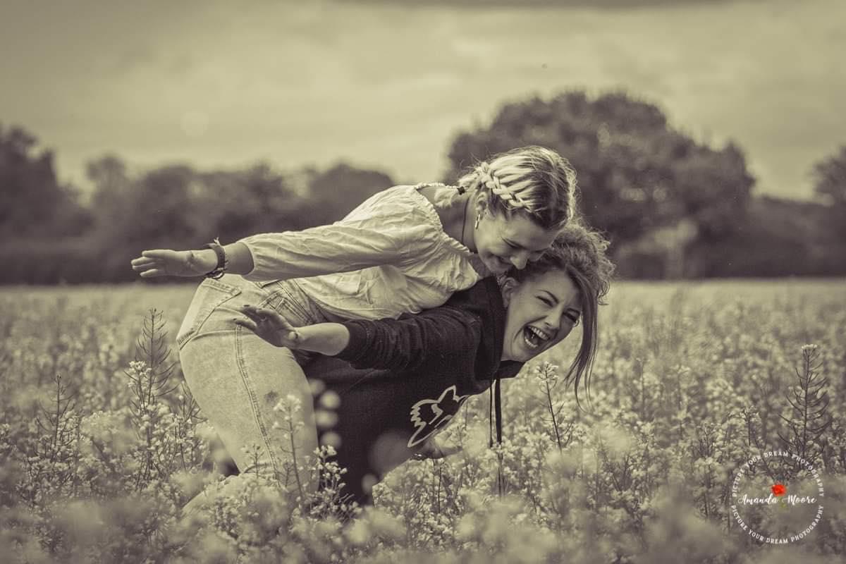 two friends in a poppy field