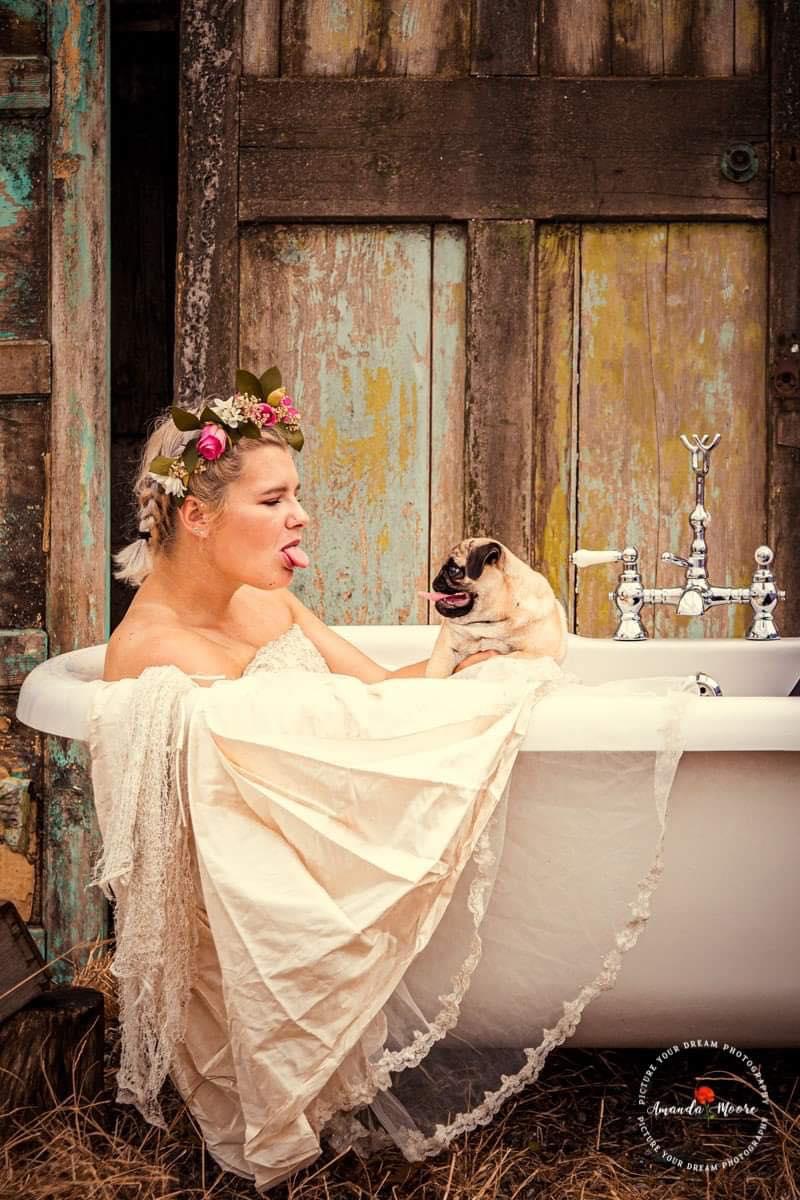 bride in a bathtub with a pug