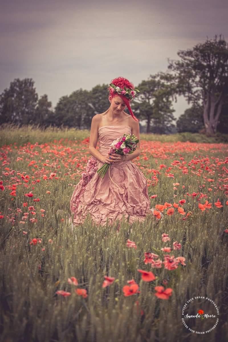 bride bridesmaid in a poppy field wedding photo