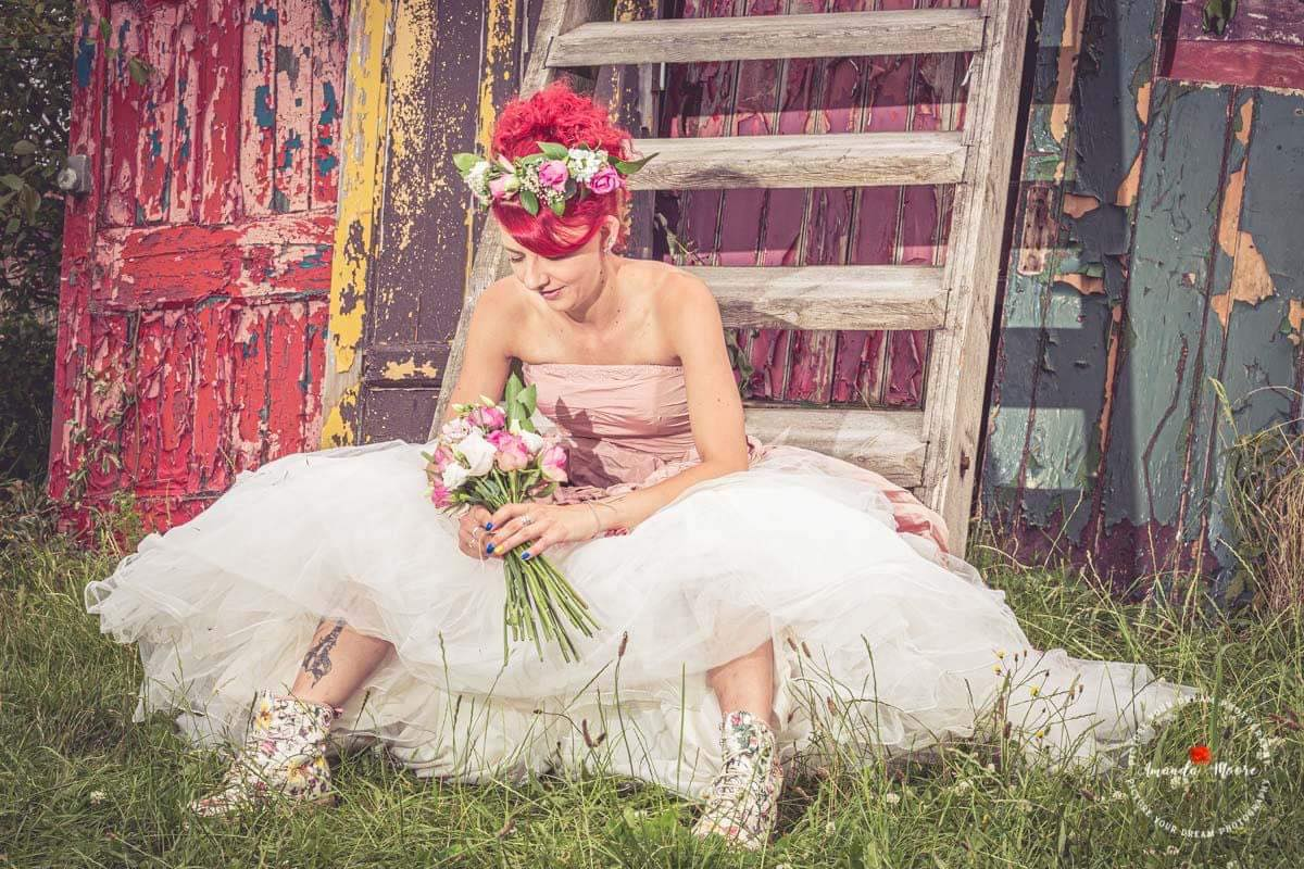 alternative bride red hair wedding dress flowers