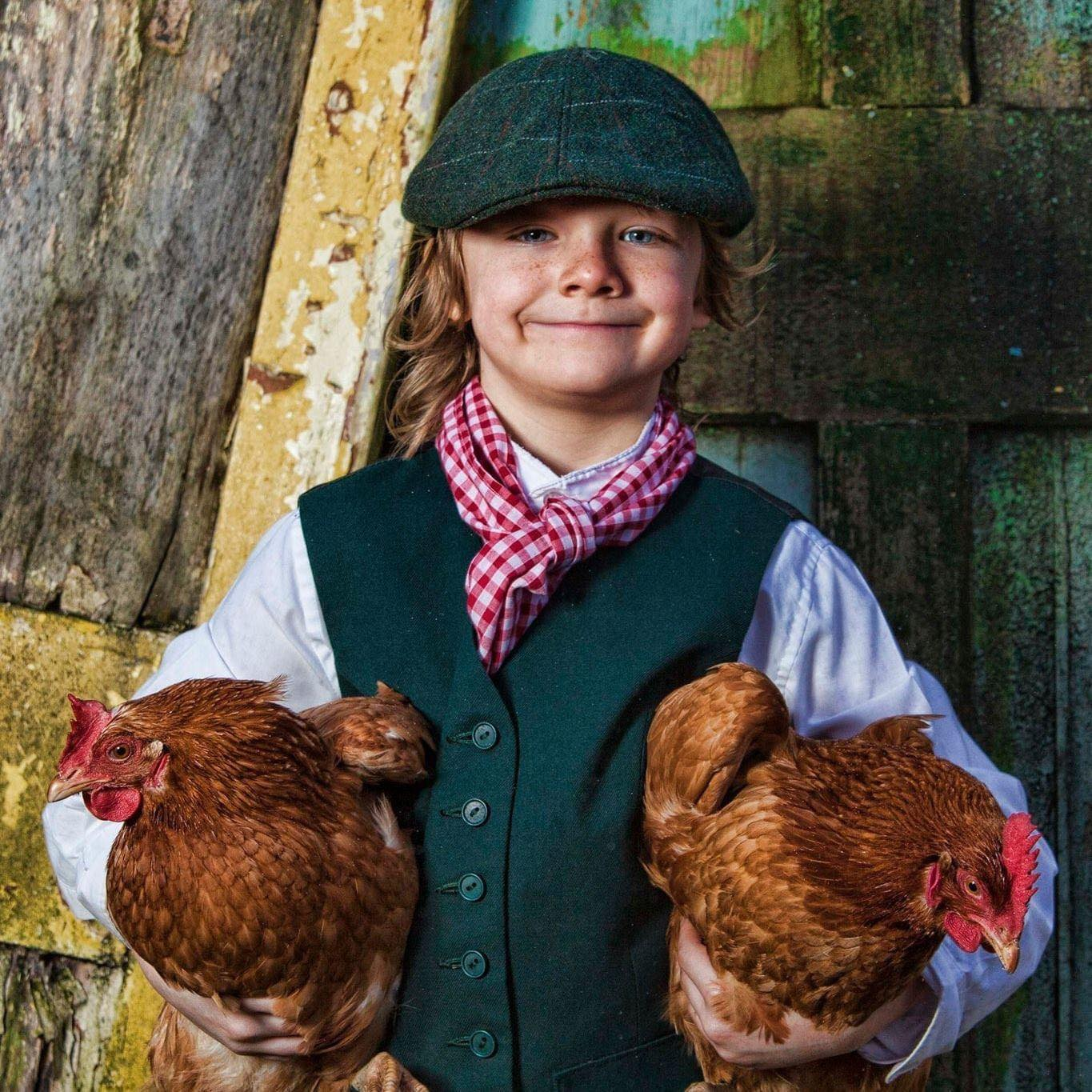 farmer boy with his chickens