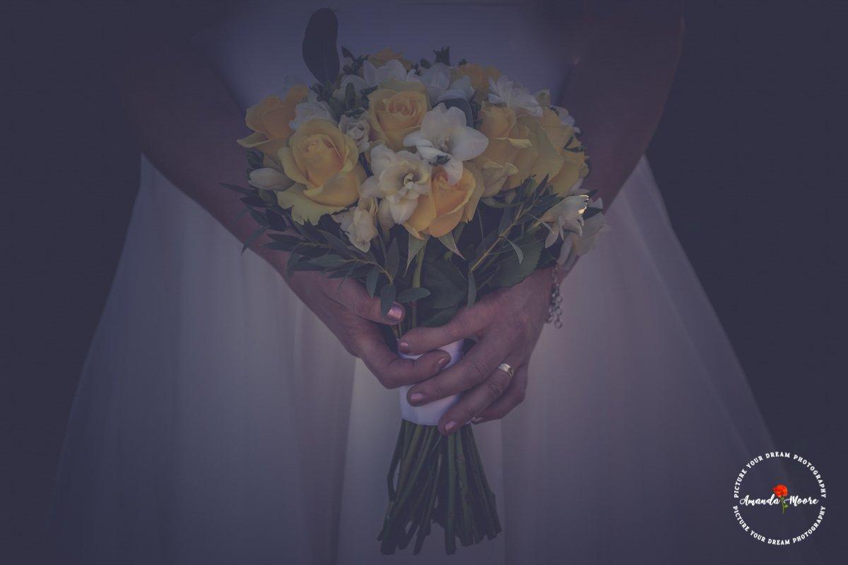 bride holding flowers wedding photograph