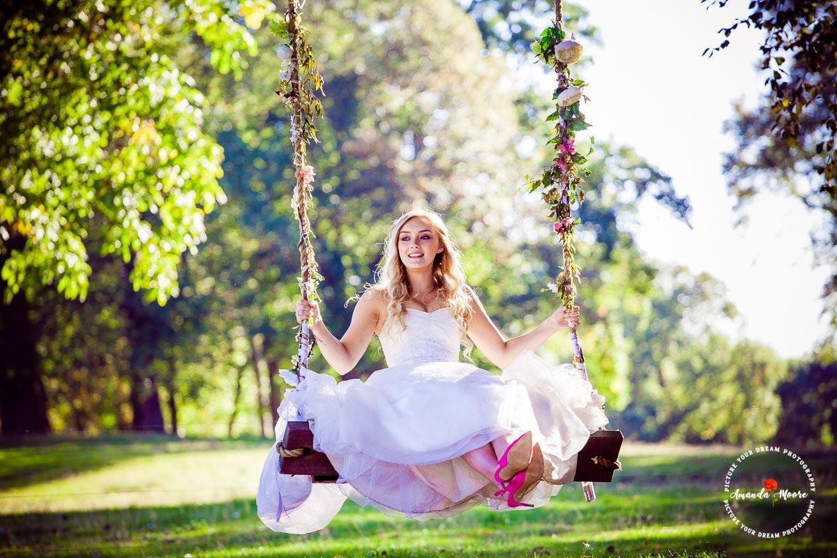 Bride on a swing wedding photograph