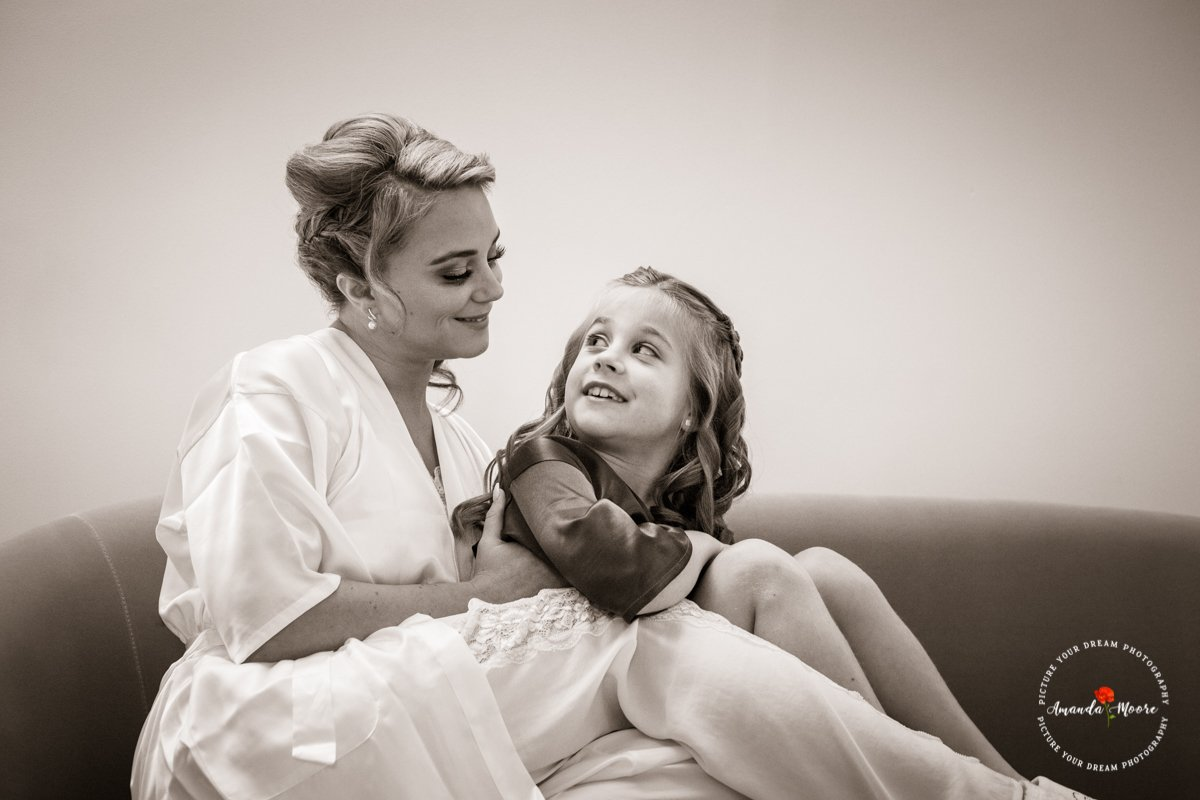 bride with little girl bridesmaid