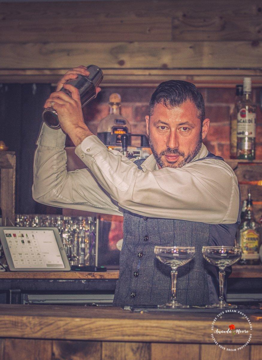 bartender shaking cocktails at wedding