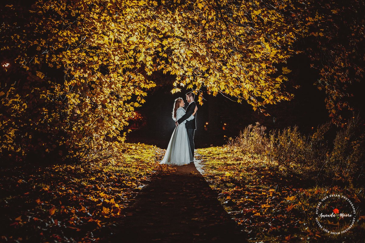 bride and groom in trees in forest
