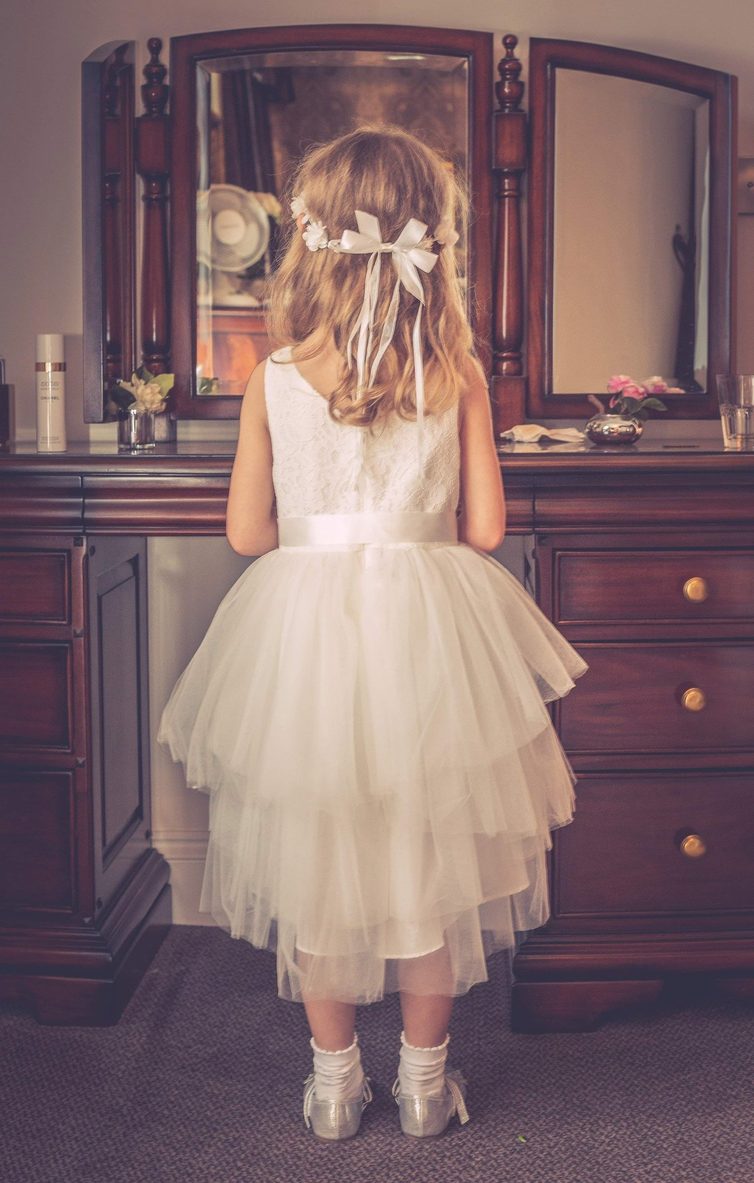 girl at wedding looking in the mirror