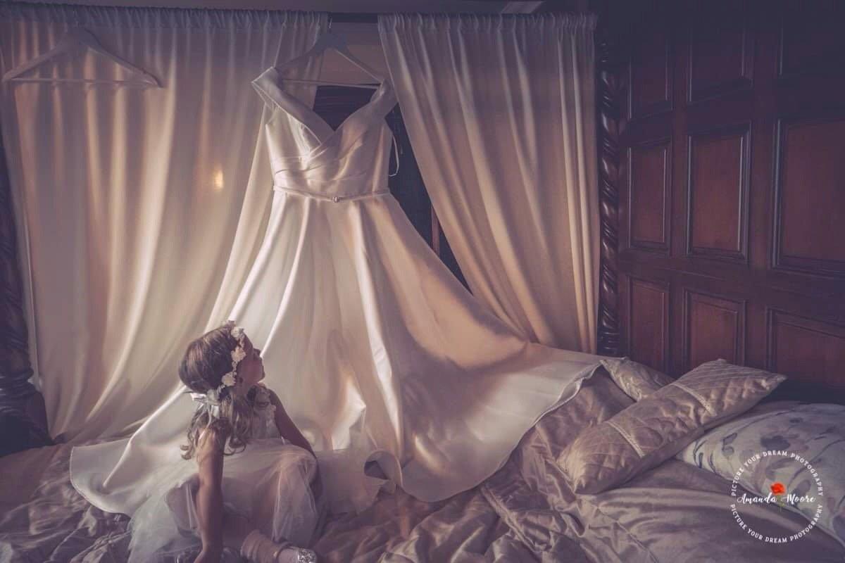 girl looking at wedding dress photo