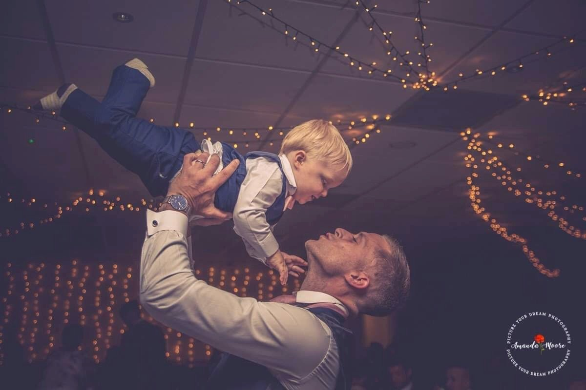 groom with child at wedding