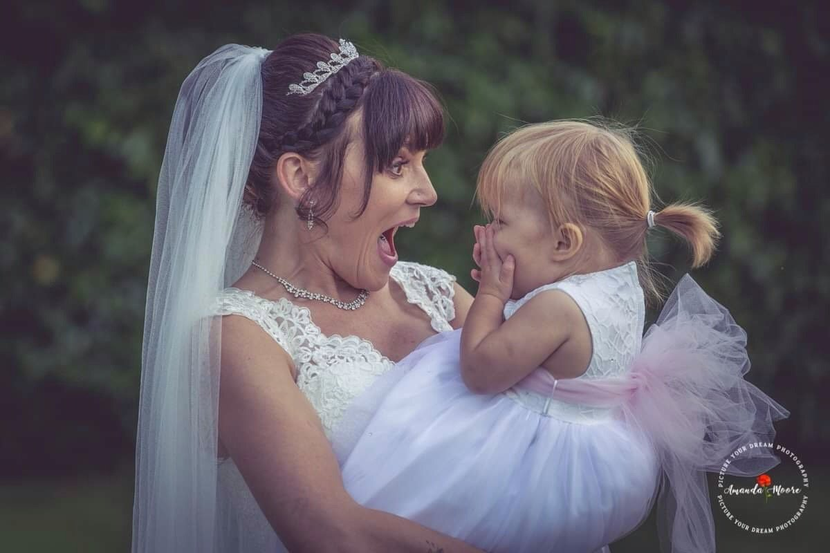 bride with baby at wedding