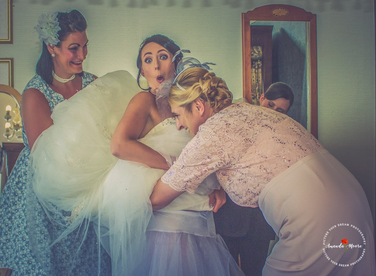 Bride putting her wedding dress on funny photo