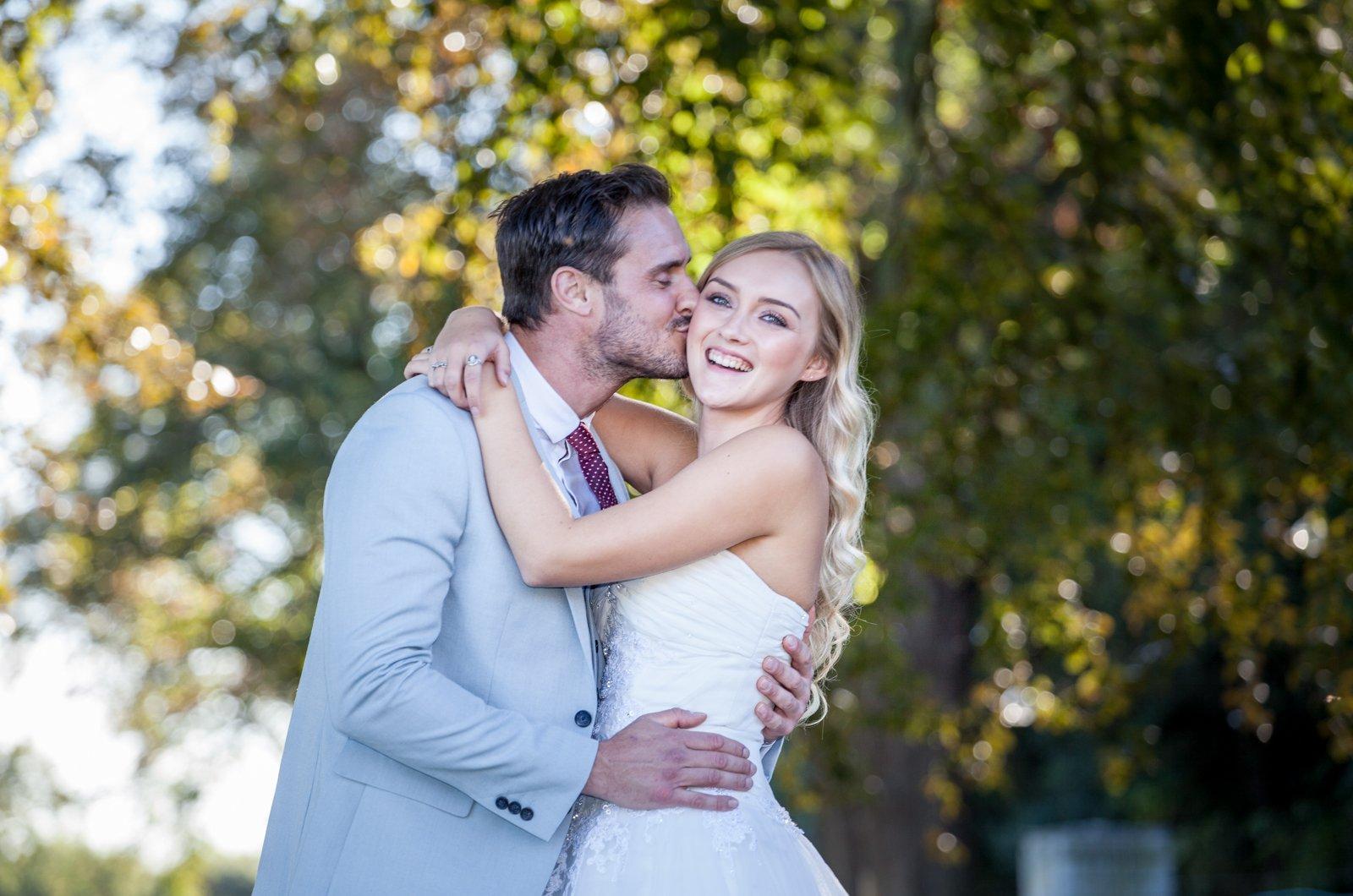Bride groom kiss wedding photograph