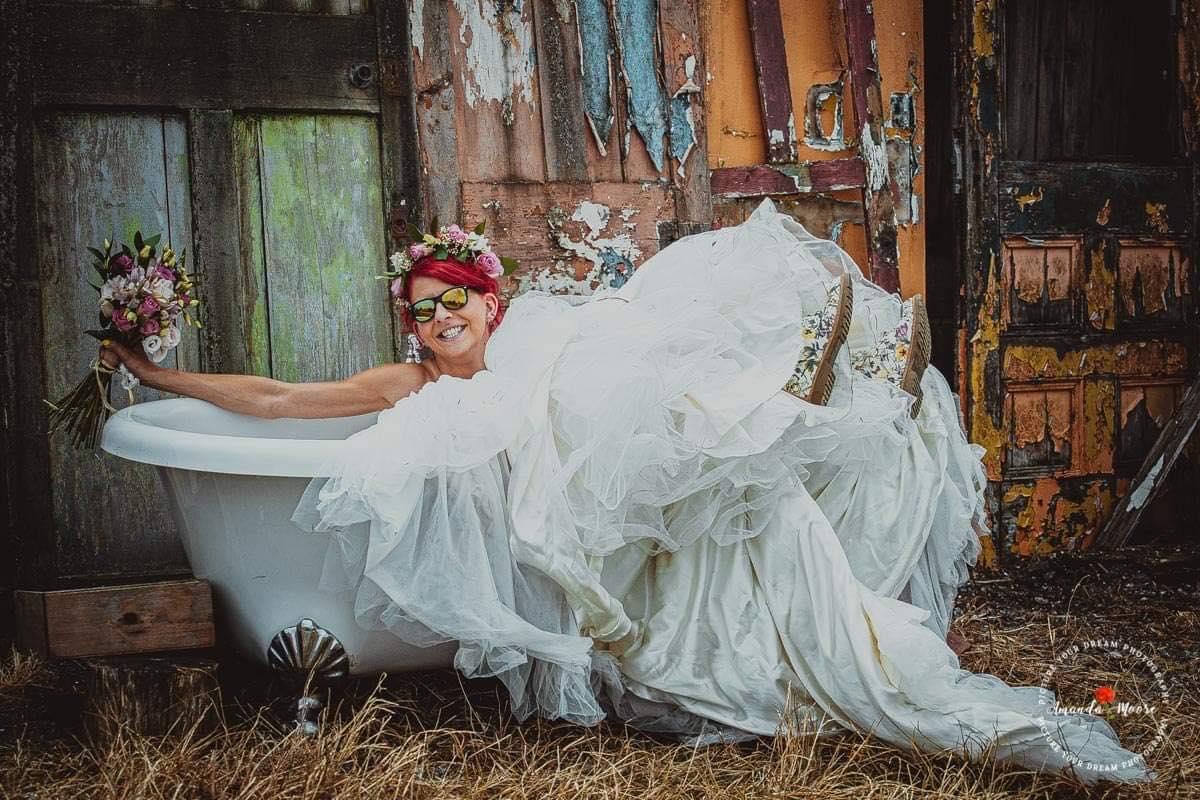 bride in a bathtub wedding photo