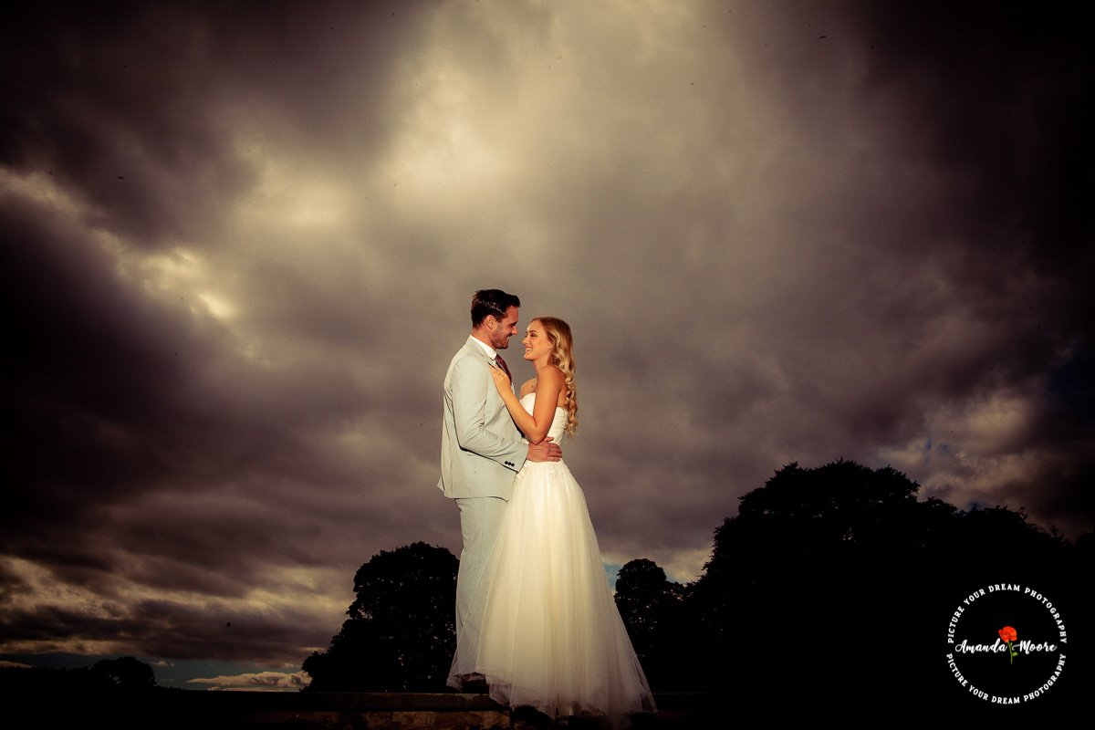 Bride and groom dramatic sky wedding photograph